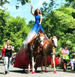 Fairland Ferguson rides her horses, Henry and Poncho, in Staunton's Fourth of July Happy Birthday America parade Thursday morning.