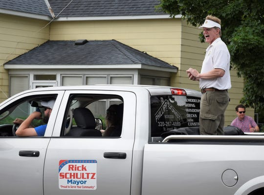 St. Joseph Mayor Rick Schultz interacts with residents lining the street for the Joetown Rocks Parish Festival parade Thursday, July 4, 2019 in St. Joseph.