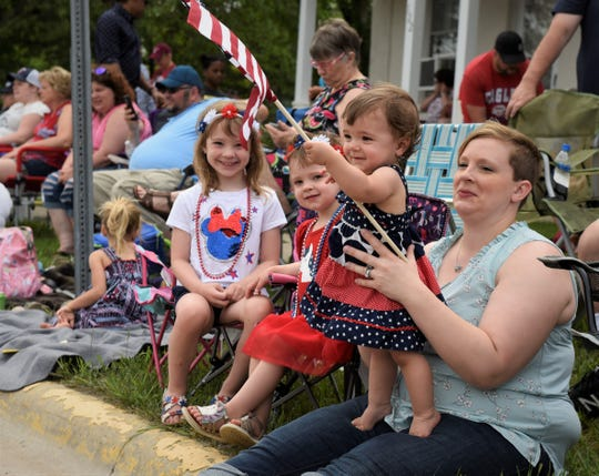 Sauk Rapids resident Renee Bloch watches the Joetown Rocks Parish Festival parade Thursday, July 4, 2019 with daughters, from left, 7-year-old Morgan, 3-year-old Olivia and 1-year-old Kennedy.