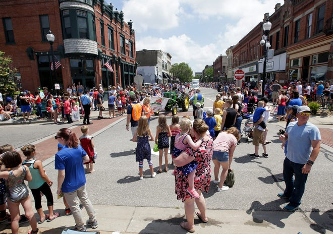 Spectators line downtown to watch the Independence Day parade on Thursday, July 4, 2019, along Main Street in Stevens Point, Wis. 