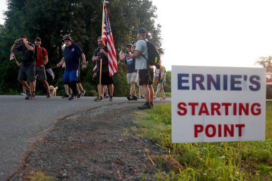 Ernie Andrus leads the way as he and about ten others walk four miles through Monticello, Fla. July 4, 2019. Andrus is a World War II veteran who is walking across the country for a second time while in his nineties.