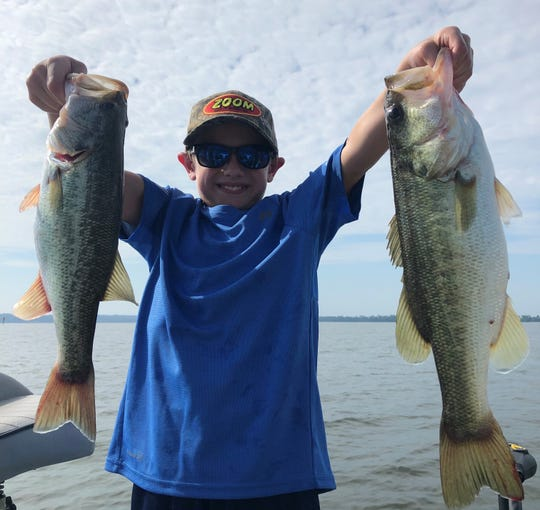 10-year-old Chase Anderson of Tallahassee with two fine Lake Seminole bass he caught while fishing with guide Paul Tyre.