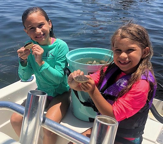 Brooke and Baylee Schamow are all smiles with their scallop catch out of Steinhatchee.