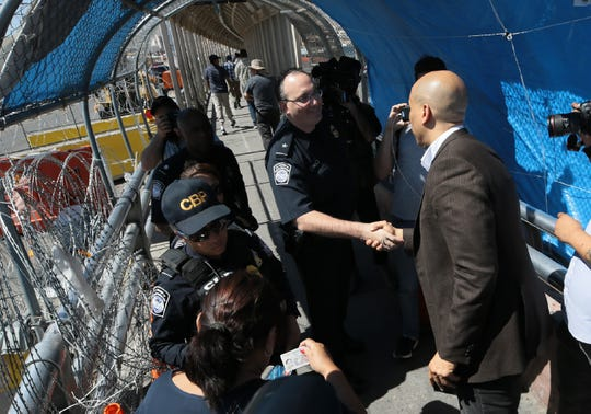 A group of five women were escorted across the Paso del Norte International bridge between El Paso, Texas and Juarez, Chihuahua, Mexico Wednesday, July, 3, 2019. The women were escorted by attorneys from Las Americas Immigrant Advocacy Center, Families Belong Together and Democratic Presidential Candidate Sen. Cory Booker. The women, who are considered high risk after experiencing trauma in Mexico, covered their faces with folders containing their asylum paperwork as they crossed to shield their identities.