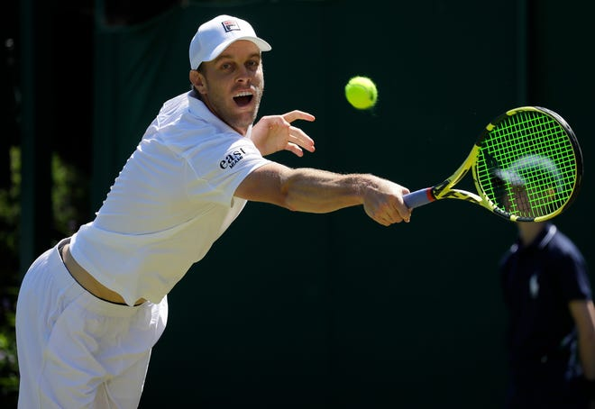 Thousand Oaks native Sam Querrey stretches to hit a backhand during his straight-sets victory over Russia's Andrey Rubley in a second-round match at Wimbledon on Thursday.