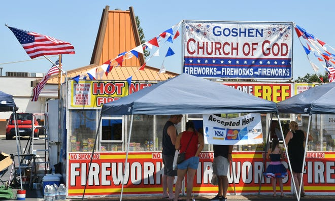 Vandals tore down and burned American flags at Goshen Church of God's fireworks booth on Mooney Boulevard on Tuesday night.