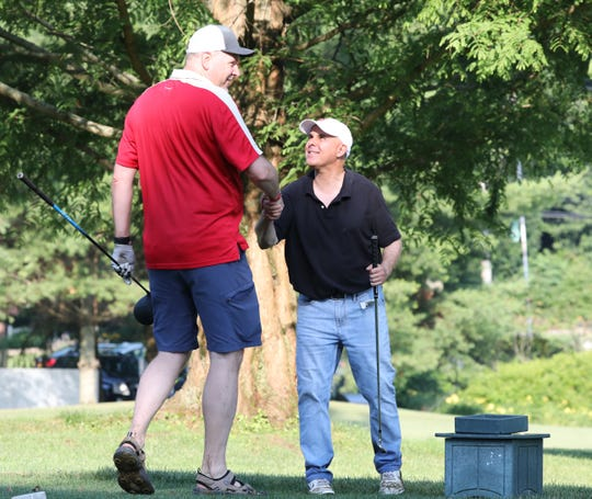 Steve Simmons greets Bill Sabia, both from Port Chester, on the 10th tee at Maple Moor Golf Course, July 4, 2019. The course opened that day after many months of renovations.