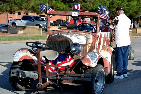 Clint Lee drives his patriotic-themed classic car in the annual Kell House Fourth of July parade that meandered through downtown Wichita Falls.