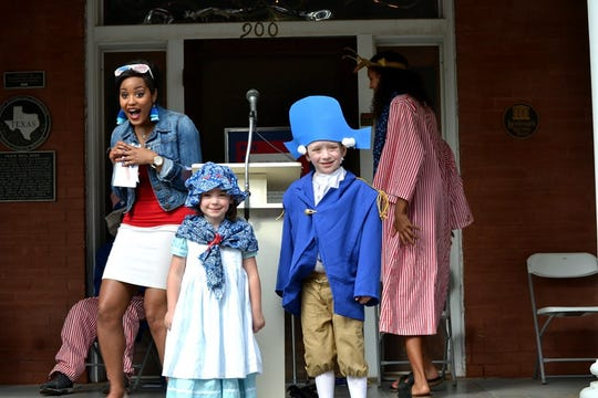 Little Martha and George Washington donned their patriotic best as they competed in the costume contest at the Kell House Thursday.  Melanie Townsend of KFDX, served as a joyful master of ceremonies.