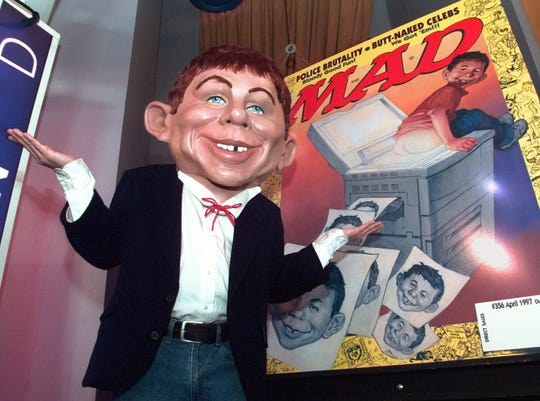 MAD magazine mascot Alfred E. Neuman, seen here in 1997 unveiling a new look for the satirical magazine, will be disappearing from newsstands after the August issue.