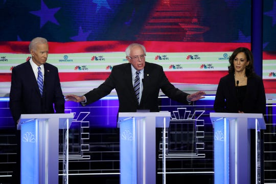 Former Vice President Joe Biden, left, Sen. Bernie Sanders and Sen. Kamala Harris during the second night of the Democratic presidential debates in Miami.