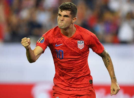 Christian Pulisic celebrates the first of his two goals against Jamaica in the Gold Cup semifinals.
