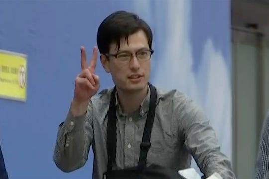 Australian student Alek Sigley gestures as he arrives at the airport in Beijing on Thursday, July 4, 2019. The Australian student who vanished in North Korea more than a week ago arrived in Beijing on Thursday morning.