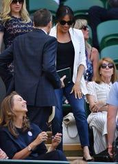 Duchess Meghan arrives to watch pal Serena Williams take on Kaja Juvan at Wimbledon on Thursday.