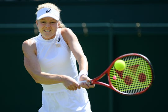 Harriet Dart of Great Britain plays a backhand in her Ladies' Singles second round match against Beatriz Haddad Maia of Brazil during Day four of The Championships - Wimbledon.