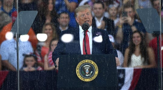 "US President Donald Trump speaks during the ""Salute to America"" Fourth of July event at the Lincoln Memorial in Washington, DC, July 4, 2019."