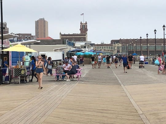Asbury Park boardwalk returns a day after a shooting marred the Fourth of July.