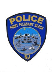 The shield and patch of the Point Pleasant Beach Police Department.