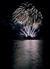 Fireworks explode over the lake at Nelson Park on July 4 last year. The fate of this year's Freedom Festival show and fireworks display still is being determined.