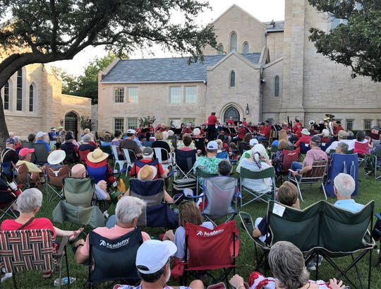 Shaded by stately Episcopal Church of the Heavenly Rest, Joe Stephens directs the Abilene Community Band in its  traditional patriotic lawn concert for the Fourth of July. July 4 2019