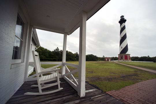 The Cape Hatteras Lighthouse is seen from the porch of the light keepers house in Buxton in 2015. The lighthouse moved to its current spot 20 years ago this summer.