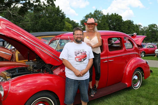Mendy and Robert Arsenault pose with their 1939 Fort Deluxe, the same car pictured on the Cars in the Park T-shirt in the Triple Cities Street Rods' 2017 Cars in the Park event.