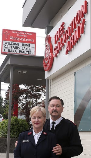 Salvation Army Captains Lance and Dana Walters stand in front of the organization's Sixth Street facility in downtown Bremerton. The pair say they are getting up to speed on operations and plans to open a cold-weather shelter at the site again this winter.
