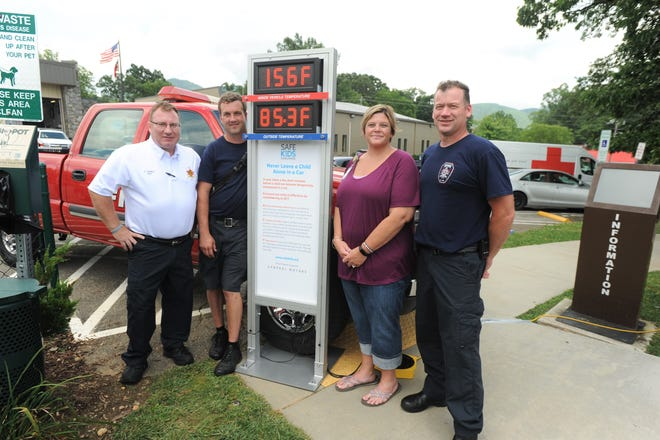 From left to right: Black Mountain fire chief Scottie Harris, Brad Williams, Vickie Killough and Joseph Snyder raise awareness of the dangers of leaving children in hot cars in Town Square on July 5.