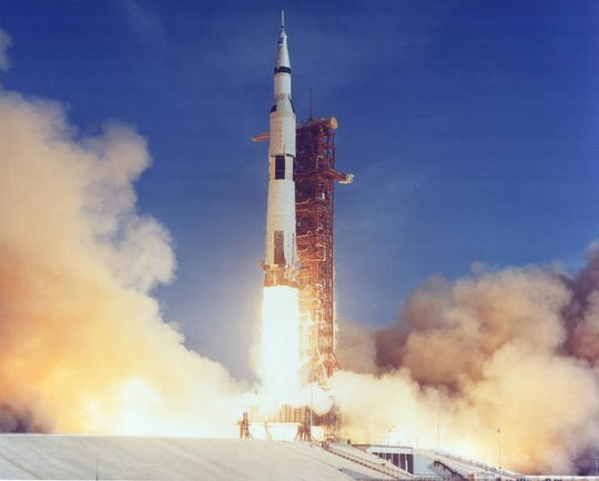 "The Apollo 11 Saturn V lifts off with astronauts Neil Armstrong, Michael Collins and Edwin ""Buzz"" Aldrin Jr. at 9:32 a.m. EDT July 16, 1969, from Kennedy's Launch Complex 39A."
