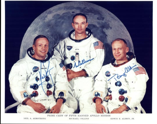 Official photo of the Apollo 11 prime crew. From left to right are NASA astronauts Neil Armstrong, commander; Michael Collins, Command Module pilot; and Buzz Aldrin, Lunar Module pilot.
