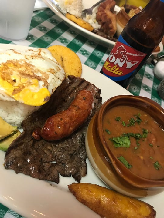 Tavo's Table, which serves authentic Colombian fare such as this mini paisa platter with chorizo, opened recently on Merritt Island.