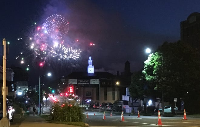 Fireworks erupt on the Burlington waterfront, as seen from Main Street on July 3, 2019.