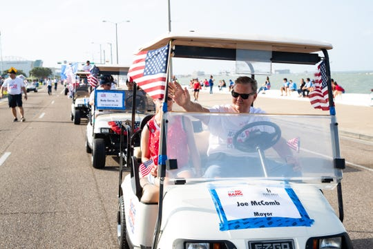Mayor Joe McComb waves during the Flint Hills Resources Patriotic Parade on July 4, 2019.