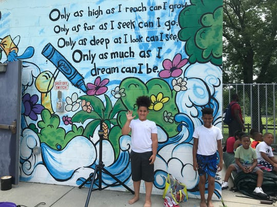 Sanathian Diaz, left, and his friend Gabriel Paul wait for the pool at the North Camden Community Center to open for the 2019 summer season.
