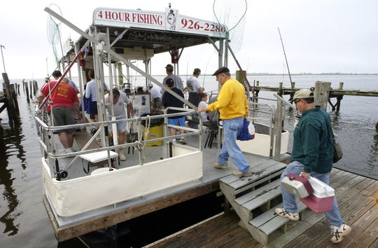 Passengers board the Duke O'Fluke in 2005. The fishing party boat came to the rescue of two South Jersey men who became caught in a rip current at the Malibu Beach Wildlife Area.