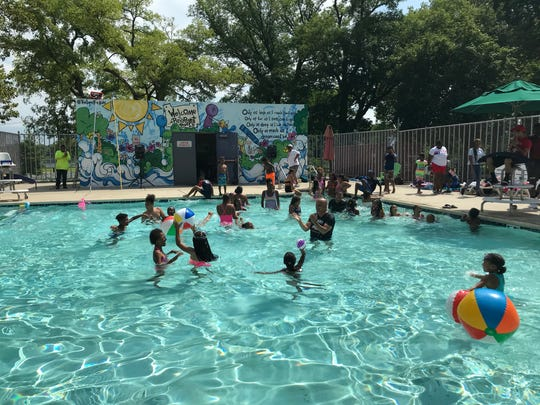 Camden Mayor Frank Moran joins children in the pool at the North Camden Community Center. The center opened this week with numerous upgrades, including air conditioning and improvements to its indoor basketball court.