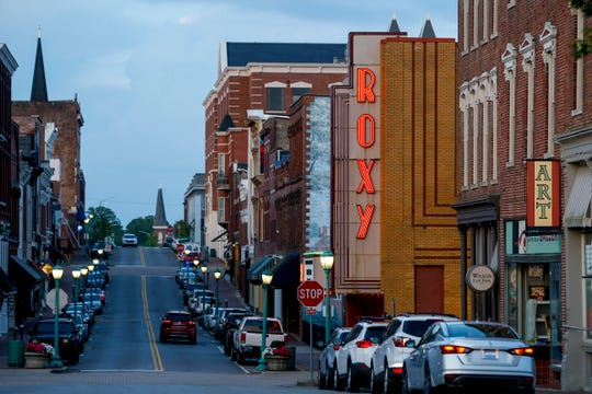 Looking down Franklin Street with a lit Roxy sign at Historic Downtown in Clarksville, Tenn., on Tuesday, July 2, 2019.
