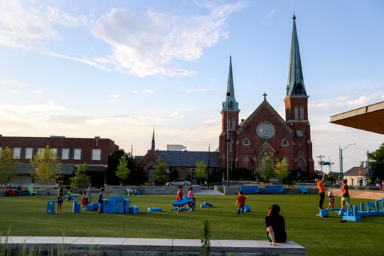 Families enjoy the evening at the Downtown Commons in Clarksville, Tenn., on July 3, 2019.