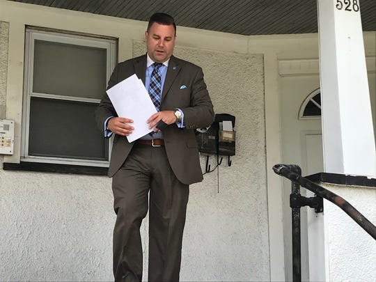 Union County Homicide Task Force Sgt. Andy Dellaquilla exits the front of a Hussa Street home in Linden after dropping off posters offering a reward in the 2012 homicide of Amber Duncan-Wilson.