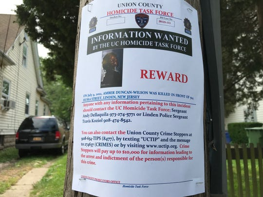 The poster placed along Hussa Street in Linden that police are hoping will help solve the 2012 fatal shooting of 18-year-old Amber Duncan-Wilson, just days after she graduated from high school.