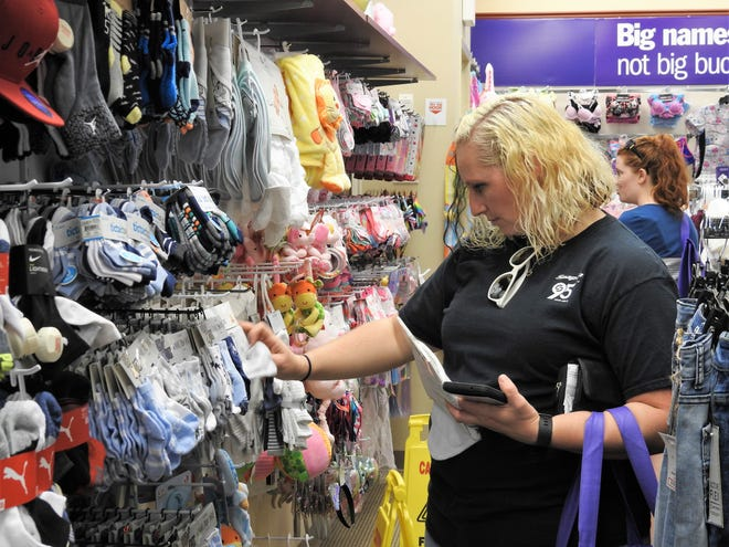Erin Porter shops for children's clothes at the recently open Gordmans on Airport Road. The off-price store will offer new inventory every week. It replaces the Peebles formerly at the same location.