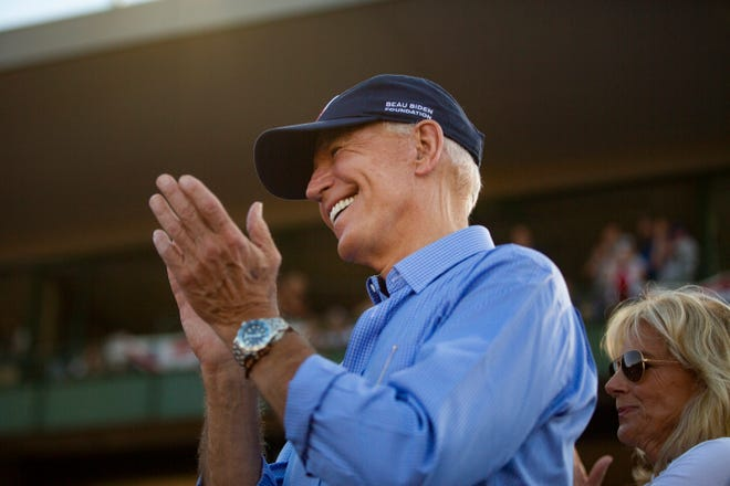 Former Vice President Joe Biden applauds as citizens are naturalized on July 4 at Principal Park in Des Moines.