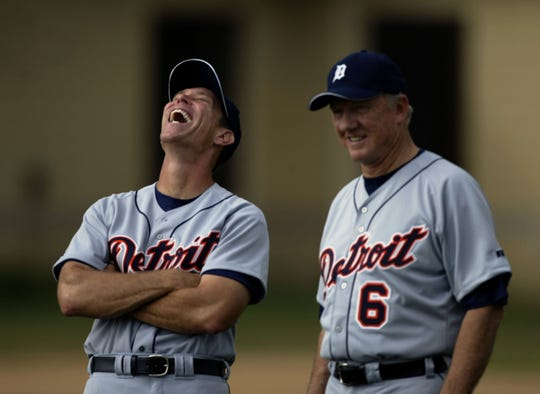 Former Detroit Tigers'  Manager Alan Trammell, left, gets a laugh out of a conversation with Hall of Famer Al Kaline, right, during their morning  practice at the Tigers Spring Training complex in Lakeland, Florida on Friday, Feb 21, 2003.