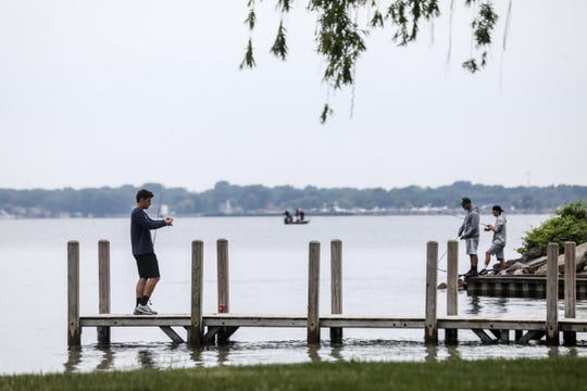 A group of friends fish near the boat launch at Lake St. Clair Metropark in Harrison Twp., Mich. on Saturday, June 9, 2018.