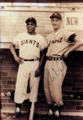 Willie Mays and Al Kaline pose for a photo after a Cooperstown Hall of Fame exhibition game in New York in the 1950s.
