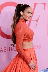 Jennifer Lopez poses with the Fashion Icon Award during Winners Walk during the CFDA Fashion Awards at the Brooklyn Museum of Art on June 03, 2019, in New York City.