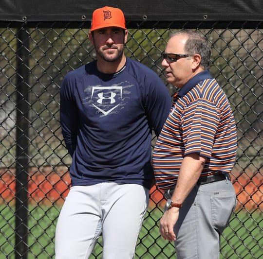 Detroit Tigers pitcher Justin Verlander, left, and general manager Al Avila talk during spring training Friday, Feb. 17, 2017, in Lakeland, Florida.