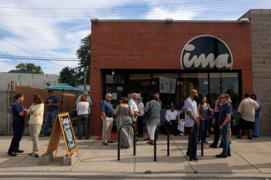 A crowd gathers at Ima's Corktown location in July 2017.