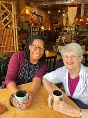 Kendra Avila and Sister Barbara Hansen of the group Sisters and Seekers meet at the Global Infusion cafe and fair trade store in Grand Rapids.