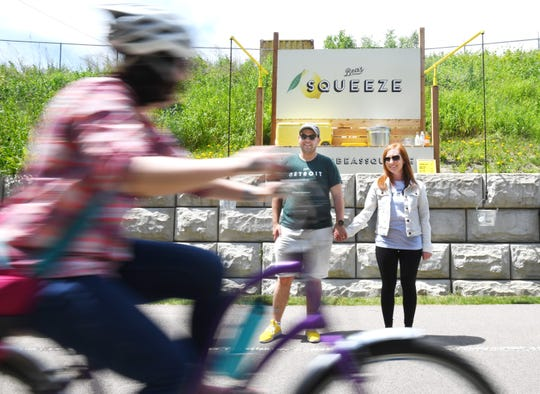 Eli and wife, Bea Wolnerman, of Bea's Squeeze, a 650-square-foot parcel that serves joggers, walkers and cyclists along the Dequindre Cut in Detroit with lemonade, orange cream and water to joggers, walkers and bikers.